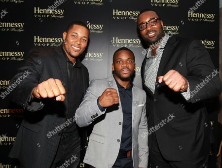 New York Mets pitcher Jeurys Familia left, Boxer Eddie Gomez center and NFL player Chris Canty are seen at Hennessy V.S.O.P Privilege Celebrates Hennessy All-Star Jeurys Familia at Stage 48, in New York