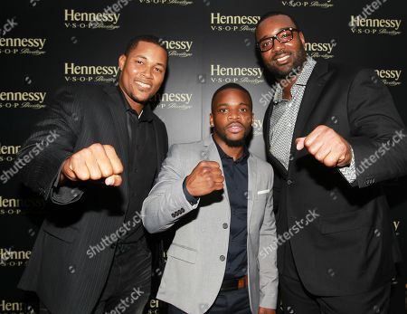 Stock Photo of New York Mets pitcher Jeurys Familia left, Boxer Eddie Gomez center and NFL player Chris Canty are seen at Hennessy V.S.O.P Privilege Celebrates Hennessy All-Star Jeurys Familia at Stage 48, in New York