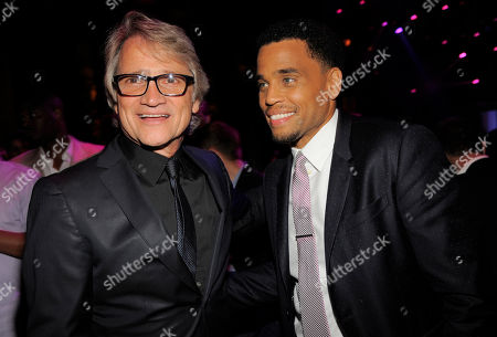 """Clint Culpepper, left, president of Screen Gems, poses with Michael Ealy, a cast member in """"Think Like A Man Too,"""" at the post-premiere party for the film on in West Hollywood, Calif"""