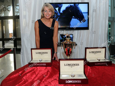 Stock Picture of Jennifer Judkins, Longines U.S. Brand President, poses with the Kentucky Derby trophy and Longines timepieces at the Taste of Derby, in Louisville, Ky. Longines, the Swiss watch manufacturer known for its luxury timepieces, is the Official Watch and Timekeeper of the 141st annual Kentucky Derby