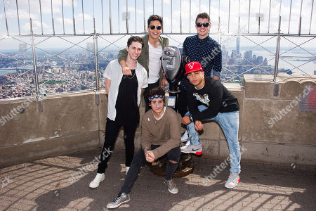 Stock Picture of Midnight Red band members, clockwise from left, Eric Secharia, Thomas Augusto, Colton Rudloff, Joey Diggs Jr. and Anthony Ladao visit the Empire State Building on in New York