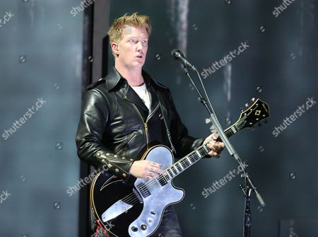 Joshua Homme, of Queens of the Stone Age, performs at the 56th annual Grammy Awards in Los Angeles. Homme, also a member of Eagles of Death Metal, was scheduled to perform Nov. 13, 2015, at the Bataclan venue in Paris. Band members Jesse Hughes and Homme told VICE on Friday, Nov. 20, that several people hid in their dressing room during the deadly terrorist attack in Paris on Nov. 13