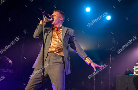"""Macklemore and Ryan Lewis performing at the Yahoo! On the Road Concert Series at Turner Hall, in Milwaukee, Wis. """"Can't Hold Us"""" by Macklemore & Ryan Lewis featuring Ray Dalton is the top streamed track on Spotify from Monday, June 3, to Sunday, June 9"""