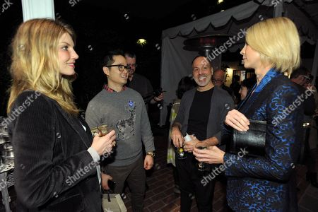 Angela Lindavall, left, Danny Seo, second from left, and Jenna Elfman, right, attend the Stella McCartney holiday party sponsored by Ford C-MAX Hybrid on in West Hollywood, Calif