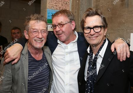 """Stock Picture of From left, cast member John Hurt, director Michael Colgan and actor Gary Oldman pose backstage after the opening night performance of """"Krapp's Last Tape"""" at Center Theatre Group's Kirk Douglas Theatre, in Culver City, Calif"""