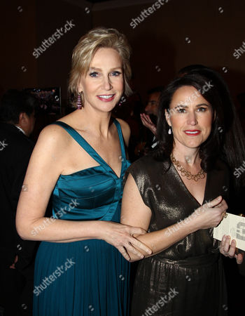 Actress Jane Lynch, left, and Lara Embry attend the 70th Annual Golden Globe Awards at the Beverly Hilton Hotel, in Beverly Hills, Calif