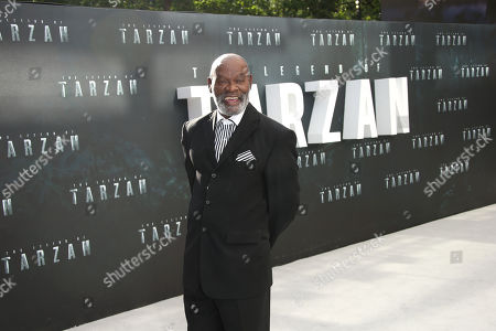 Actor Yule Masiteng poses for photographers upon arrival at the premiere of the film 'The Legend Of Tarzan' in London