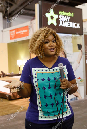 Food Network host Sunny Anderson is pictured outside the Extended Stay America traveling hotel room, seen at the New York City Wine & Food Festival