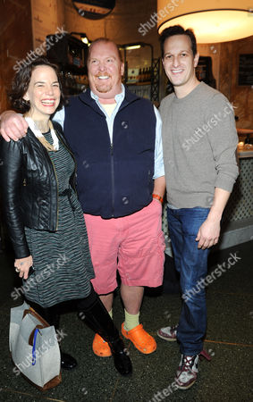 FOOD & WINE editor in chief Dana Cowin, left, joins actor Josh Charles, right, to congratulate Mario Batali, center, the guest-editor of the April issue of FOOD & WINE, during a party at Eataly in New York