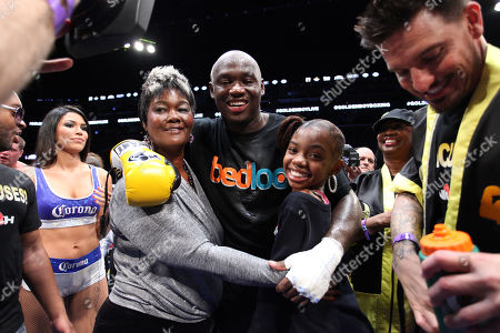 "Stock Image of Heavyweight Antonio Tarver celebrates with family after knocking out Mike Sheppard in the 4th round during the ""Golden Boy Boxing Live! Presents Tarver vs Sheppard"" on Tuesday, Nov., 26, 2013 at the BB&T Center in Sunrise, FL"