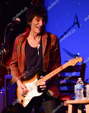 Musician Ronnie Wood of the Rolling Stones performs with guitarist Mick Taylor, drummer Simon Kirke and keyboardist Al Cooper in a rare club appearance at The Cutting Room on in New York