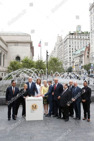 "From left, Mitchell Silver,Carolyn Maloney, David H. Koch, Julia Koch, Emily K. Rafferty, Thomas P. Campbell, Daniel Brodsky, Jerrold Nadler, Tom Finkelpearl, Jimmy Van Bramer and Jose M. Serrano as seen at the unveiling of the Metropolitan Museum of Art's new ""David H. Koch Plaza,"" on Tues., in New York"