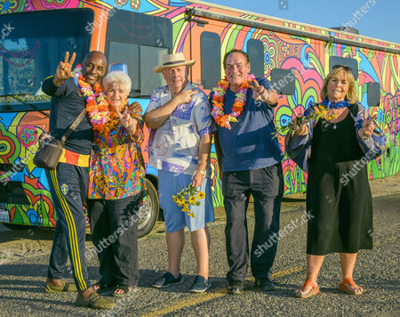 (l-r) John Fashanu, Pam St Clements, Christopher Biggins, Bobby George and Linda Robson  in front of the Magical Mystery Tour Bus