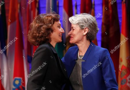 UNESCO'S new elected director-general France's Audrey Azoulay, left, and outgoing director-general Irina Bokova kiss during the 39th session of the General Conference at the United Nations Educational, Scientific and Cultural Organisation, UNESCO headquarters in Paris, . UNESCO's member states have voted to confirm the nomination of former French Culture Minister Audrey Azoulay as the body's new leader