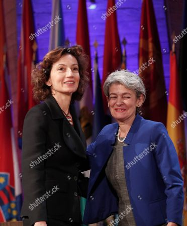 UNESCO'S new elected director-general France's Audrey Azoulay, left, and outgoing director-general Irina Bokova pose during the 39th session of the General Conference at the United Nations Educational, Scientific and Cultural Organisation, UNESCO headquarters in Paris, . UNESCO's member states have voted to confirm the nomination of former French Culture Minister Audrey Azoulay as the body's new leader