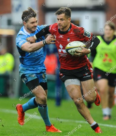Henry Trinder of Gloucester Rugby hands off Ben Ransom of London Irish