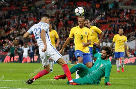 Dominic Solanke of England has a shot saved by Alisson Ramses Becker of Brazil