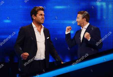 Stock Image of (l-r) Patrick Baladi and host Bradley Walsh face The Chaser