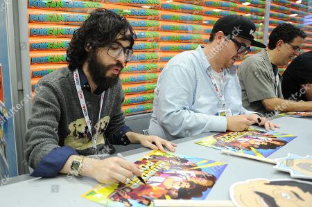 """From left, creator Jason Ruiz, Peter Atencio and creator David A. Goodman sign autographs at the FOX """"Murder Police"""" booth signing on Day 2 of Comic-Con International on in San Diego, Calif"""