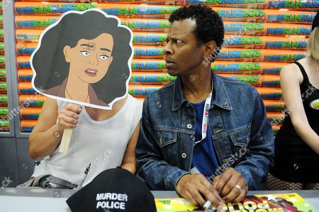 """Justina Machado, left, and Phil Lamarr attend the FOX """"Murder Police"""" booth signing on Day 2 of Comic-Con International on in San Diego, Calif"""