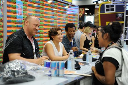 """From left, Will Sasso, Justina Machado and Phil Lamarr sign autographs at the FOX """"Murder Police"""" booth signing on Day 2 of Comic-Con International on in San Diego, Calif"""