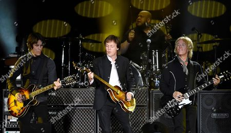 Paul McCartney, center, performs with band members, from left, Rusty Anderson, Abe Laboriel Jr. and Brian Ray on day 2 of the 2016 Desert Trip music festival at Empire Polo Field, in Indio, Calif