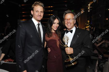 From left, Josh Pence, Abigail Spencer and producer Mark Johnson attend the AMC, IFC, Sundance Channel Emmy After Party, on in West Hollywood, Calif