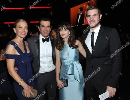Stock Photo of From left, Holly Burrell, Ty Burrell, Zooey Deschanel, and Jamie Linden backstage at the 65th Primetime Emmy Awards at Nokia Theatre, in Los Angeles