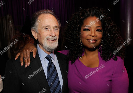 Stock Image of Lawrence Gordon, left, and Oprah Winfrey attend the 87th Academy Awards nominees luncheon at the Beverly Hilton Hotel, in Beverly Hills, Calif