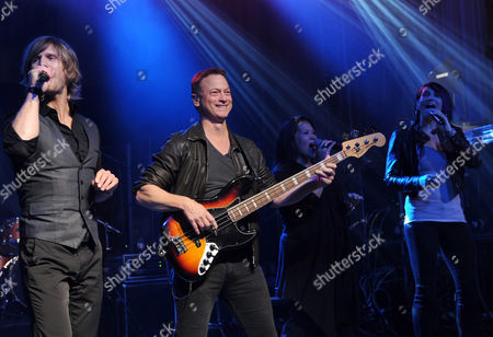 Stock Picture of Actor Gary Sinise, center, and the Lt. Dan Band perform at the Josh Cellars concert to benefit the Gary Sinise Foundation, which supports first responders, veterans and their families, in New York. Josh Cellars, a California wine brand, along with Deutsch Family Wine and Spirits and their distributor partners raised $113,900 for the Gary Sinise Foundation this year