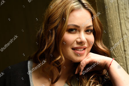 "Stock Image of Singer and television personality Janney ""Chiquis"" Rivera poses for a portrait in Los Angeles. Rivera, the daughter of the late Jenni Rivera, is promoting Jenni Rivera: Unforgettable, Baby!,"" a photo book that for the first time shows a picture of Fernando, Jenni Rivera's on and off boyfriend for about 10 years. The book was edited by The Jenni Rivera Estate and published by Atria Books on October 27"