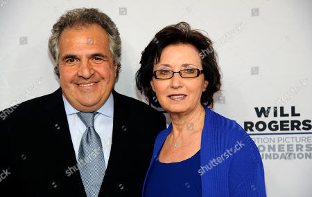 Stock Image of Madeline Sherak, widow of honoree Tom Sherak, poses with 20th Century Fox CEO Jim Gianopolus at the Pioneer of the Year dinner on the third day of CinemaCon 2014 on in Las Vegas