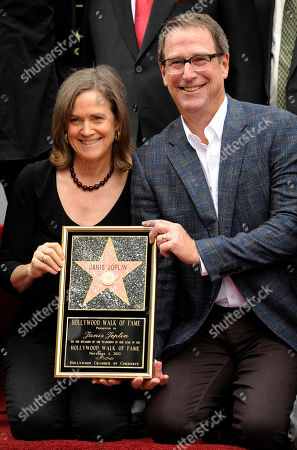 Laura and Michael Joplin, siblings of the late singer Janis Joplin, hold up a replica of her star at a ceremony honoring Joplin with a posthumous star on The Hollywood Walk of Fame on in Los Angeles