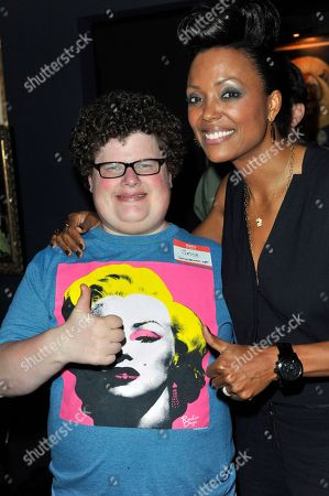 IMAGE DISTRIBUTED FOR UBISOFT - Actor Jesse Heiman poses with Aisha Tyler, Players' Lounge host, and Ubisoft's Watch Dogs during the 2013 Comic-Con International Convention, in San Diego, Calif