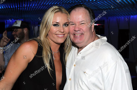 Actor Dennis Haskins, right, and Lindsey Vonn pose together at the Red Bull Sweet 16 Celebration for Lindsey Vonn, in Los Angeles