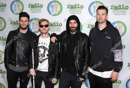 Adam Levin, from left, Casey Harris, Sam Harris and Noah Feldshuh of the band X Ambassadors pose for photographers backstage during the Radio 104.5 Summer Block Party at Festival Pier, in Philadelphia