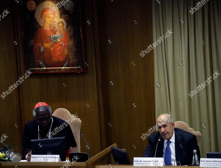 Director General Emeritus of the Intenational atomic Energy Agency and Nobel Peace laureate Mohamed ElBaradei, right, and Cardinal Peter Turkson attend a conference on nuclear disarmament, at the Vatican, . The Vatican hosted Nobel laureates, U.N. and NATO officials and a handful of nuclear powers at a conference aimed at galvanizing support for a global shift from the Cold War era policy of nuclear deterrence to one of total nuclear disarmament