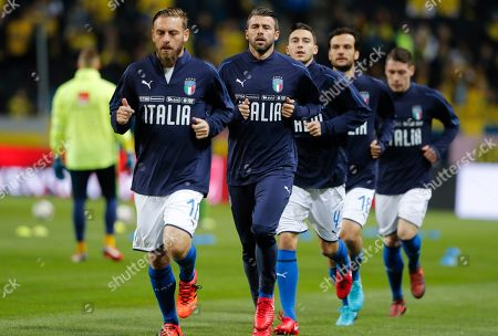 From left, Italy's Daniele De Rossi, Andrea Barzagli, Matteo Darmian, Marco Paolo and Andrea Belotti warm up prior to the World Cup qualifying play-off first leg soccer match between Sweden and Italy, at the Friends Arena in Stockholm
