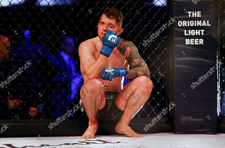 Men's Featherweight Bout. AJ McKee vs Brian Moore . Brian Moore dejected after the fight
