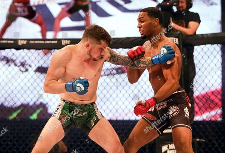 Men's Featherweight Bout. AJ McKee vs Brian Moore . Brian Moore (left) in action against AJ McKee
