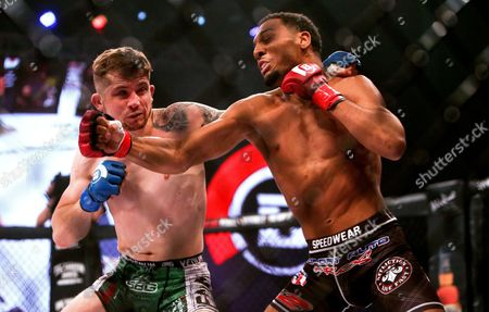 Men's Featherweight Bout. AJ McKee vs Brian Moore . AJ McKee lands a punch on Brian Moore