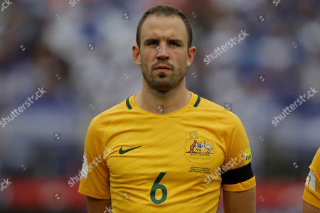 Australia's Matthew Jurman stands with his teammates during the anthems before the first leg of a World Cup qualifier play-off soccer game against Honduras at Olympic Stadium in San Pedro Sula, Honduras