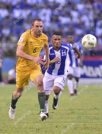 Honduran player Ricardo Canales (R) vies for a ball with Australian player Matthew Jurman (L), during the 2018 World Cup playoff match between the national soccer teams of Honduras and Australia, at the Olympic Stadium in the city of San Pedro Sula, Honduras, 10 November 2017.