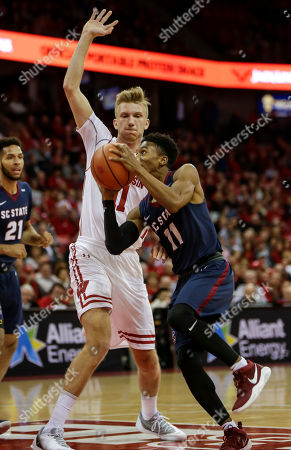 Janai Raynor Powell, Andy Van Vliet. South Carolina State's Janai Raynor Powell (11) shoots against Wisconsin's Andy Van Vliet, left, during the first half of an NCAA college basketball game, in Madison, Wis
