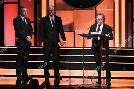 Richard Gelfond, Greg Foster, Christopher Nolan. IMAX Entertainment's Richard Gelfond, from right, and Greg Foster accept the Sid Grauman award as presenter Christopher Nolan looks on at the 31st annual American Cinematheque Award at the Beverly Hilton Hotel, in Beverly Hills, Calif