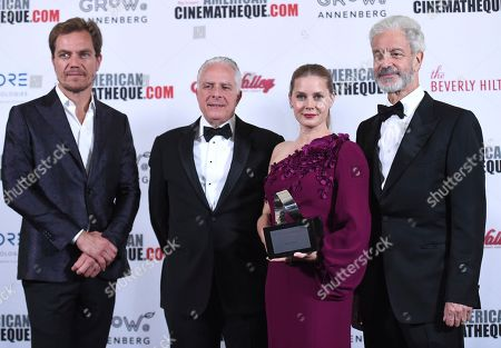 Michael Shannon, Mark Badagliacca, Amy Adams, Rick Nicita. Michael Shannon, from left, Mark Badagliacca, EVP and CFO, Paramount Pictures Corporation and president of American Cinematheque, honoree Amy Adams and Rick Nicita, board chairman, American Cinematheque, pose backstage at the 31st annual American Cinematheque Award at the Beverly Hilton Hotel, in Beverly Hills, Calif