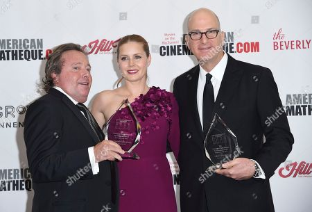 Richard Gelfond, Amy Adams, Greg Foster. IMAX Entertainment's Richard Gelfond, left, and Greg Foster, right, winners of the Sid Grauman award, and American Cinematheque award winner Amy Adams pose backstage at the 31st annual American Cinematheque Award at the Beverly Hilton Hotel, in Beverly Hills, Calif