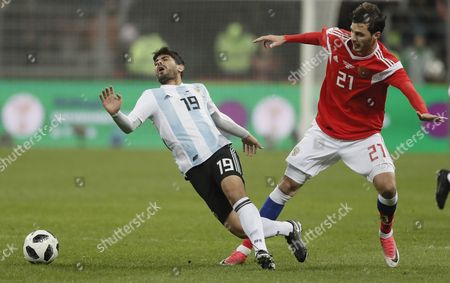 Aleksandr Yerokhin (R) of Russia fights for the ball with Ever Banega (L) of Argentina during the international friendly soccer match Russia vs Argentina at Luzhniki stadium in Moscow, Russia, 11 November 2017.