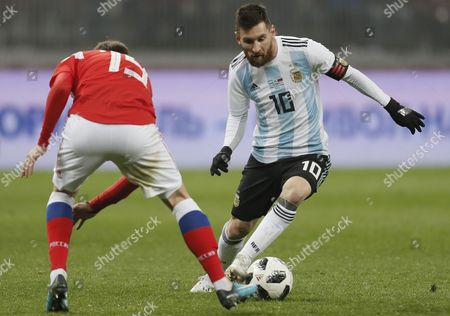Daler Kuzyayev (L) of Russia fights for the ball with Lionel Messi (R) of Argentina during their international friendly soccer match at Luzhniki stadium in Moscow, Russia, 11 November 2017.