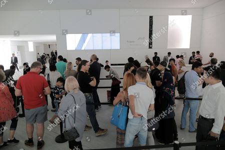 People wait line tickets during Louvre Abu Editorial Stock Photo